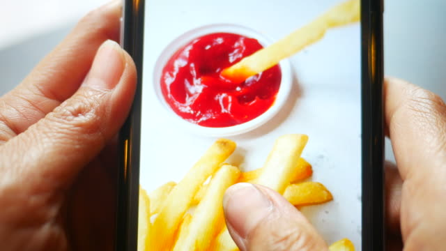taking photo shot of french fries with mobile phone video