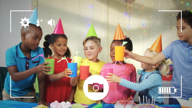 Taking photos of children at birthday party on a digital camera