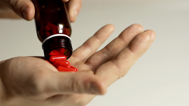 HD SLOW MOTION: Taking Pills Out Of A Bottle video