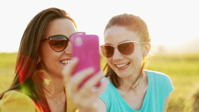 Taking selfie with mobile phone at picnic video