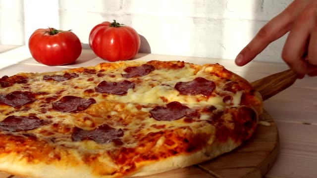 taking slice of pizza with super stretchy cheese video