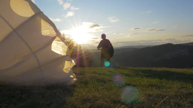 WS PAN POV Taking-off  of a Paragliding pilot, flying, cross country pilot, extreme sports, adventure