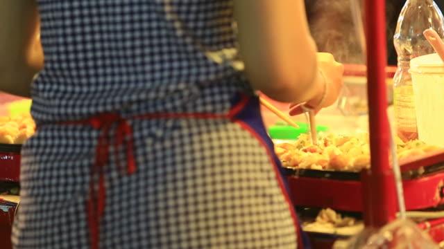 Takoyaki cooking Takoyaki cooking in street market. sashimi stock videos & royalty-free footage