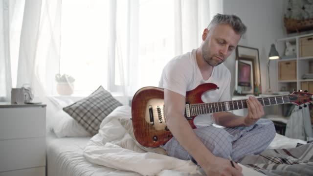 Talented Guitarist Writing Music video