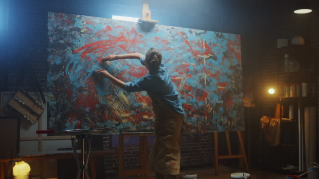 Talented Innovative Female Artist Draws with Her Hands on the Large Canvas, Using Fingers She Creates Colorful, Emotional, Sensual Oil Painting. Contemporary Painter Creating Abstract Modern Art. Zoom in video