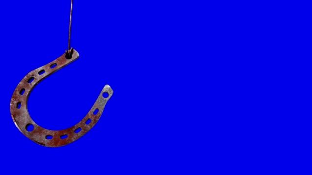 talismans good luck horseshoe on chromakey - horseshoe stock videos & royalty-free footage