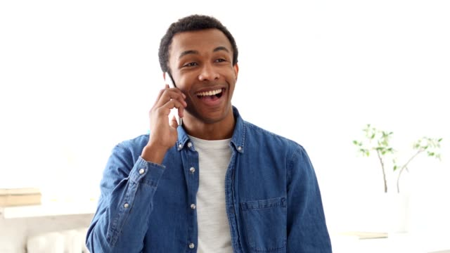 Talking on Phone, Young Afro-American Man Portrait video