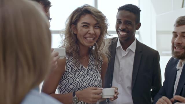 talking over cup of tea - pausa caffè video stock e b–roll