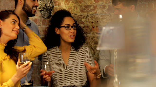 talking over drinks in a bar - attività del fine settimana video stock e b–roll