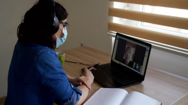 Talking with your best friend on video call in corona virus pandemic Talking with your best friend on video call in corona virus pandemic mental health stock videos & royalty-free footage