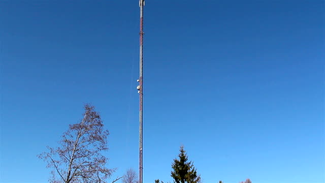 Tall mobile tower at the roadside video