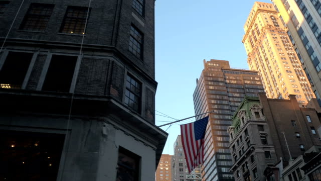 LOW ANGLE VIEW: Tall office buildings and blocks of flats in New York City video