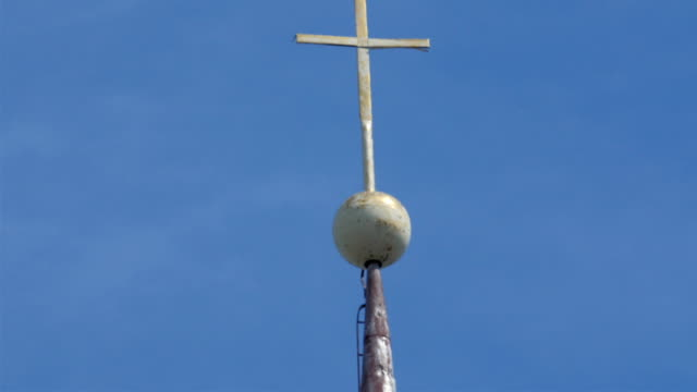 Tall pole with cross on the top video