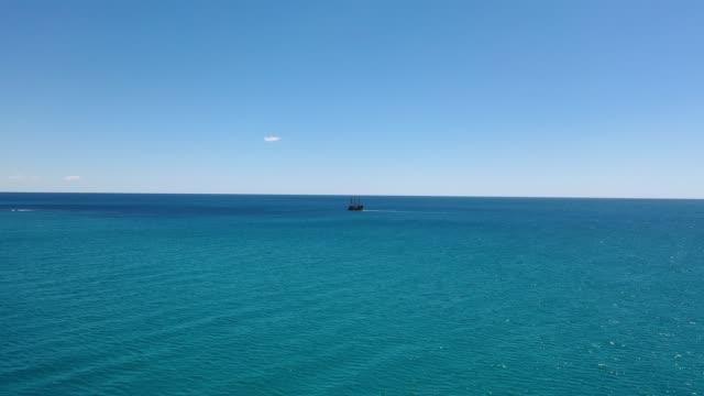 Tall ship alone on a vast blue sea