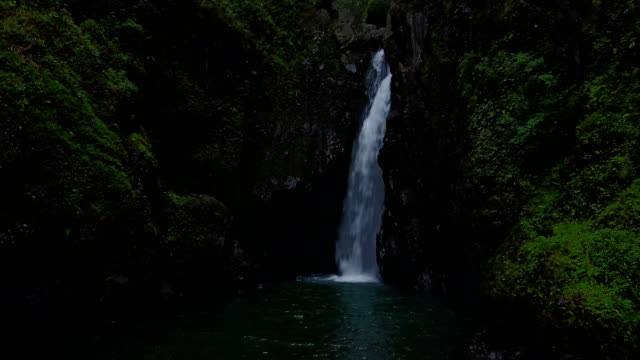 Tall Waterfall Spilling into Pool of Water on Maui Island