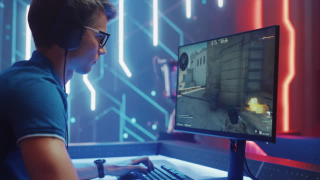 Tallinn, Estonia - 06/27/2020 EDITORIAL: Professional Esport Gamer Plays in Counter-Strike: Global Offensive Popular First-Person Shooter Video Game on a Championship. Cyber Tournament Live Streaming