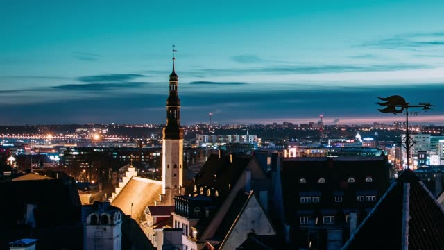 tallinn, estonia, europe. time lapse time-lapse of cityscape. transition from night to morning sunrise. old town and modern city. famous landmarks. unesco. zoom out pan panorama - estonia filmów i materiałów b-roll