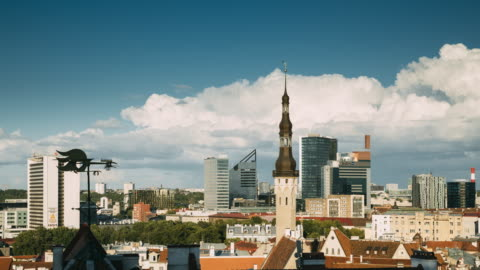 Tallinn, Estonia. Tower Of Town Hall On Background With Modern Urban Skyscrapers. City Centre Architecture. UNESCO World Heritage Site Tallinn, Estonia. Tower Of Town Hall On Background With Modern Urban Skyscrapers. City Centre Architecture. UNESCO World Heritage Site. estonia stock videos & royalty-free footage