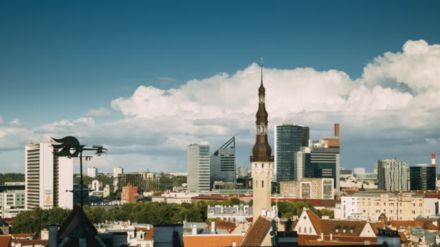 tallinn, estonia. tower of town hall on background with modern urban skyscrapers. city centre architecture. unesco world heritage site - estonia filmów i materiałów b-roll