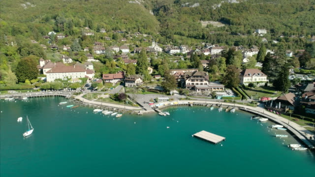 talloires, lac d'annecy - drone 4k - lakeshore stock videos & royalty-free footage