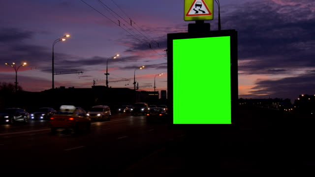 Tame lapse A Billboard with a Green Screen on a Busy Street. video