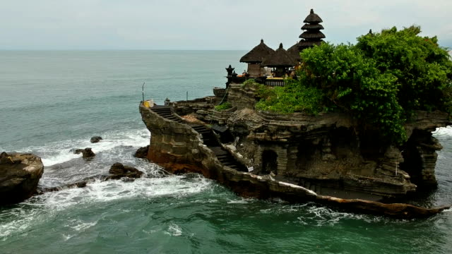 tanah lot island and temple, bali, indonesia - tempio video stock e b–roll