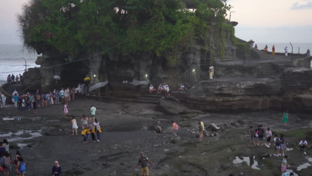 tanah lot temple on sea in bali island indonesia - tempio video stock e b–roll