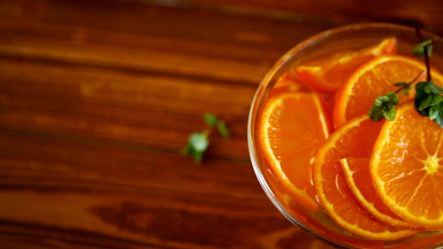 tangerine syrup in a glass bowl on a wooden table video