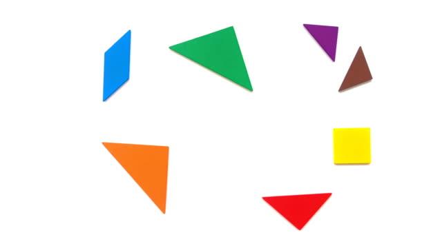 vídeos de stock e filmes b-roll de tangram shaped like differen shape of buildings on white - quebra cabeças