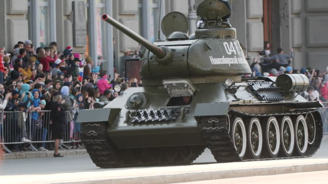 tank army military rides on the street in the parade, demonstrating its power - nazionalità russa video stock e b–roll