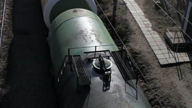 Tank cars with oil slowly go by rail. Top view