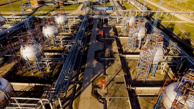 tank farm for bulk petroleum and gasoline storage next to rail line. Aerial view video
