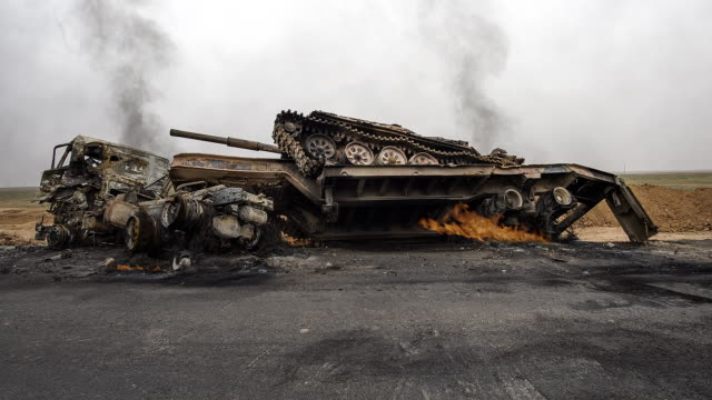 tank with truck burning, war scene tank with truck burning, war scene syria stock videos & royalty-free footage