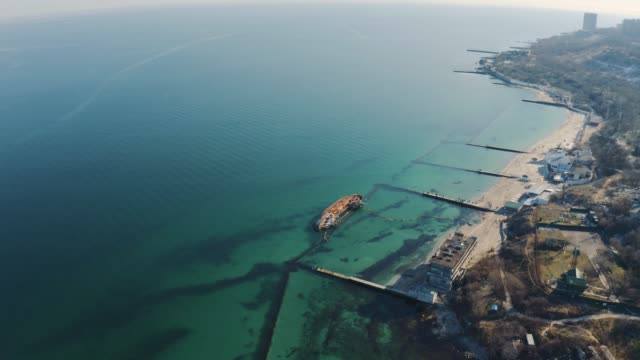 tanker crashed on the shores of the black sea. ecological disaster on the beaches of odessa in ukraine. the ship ran aground.  environmental pollution at sea. aerial view - chiatta video stock e b–roll