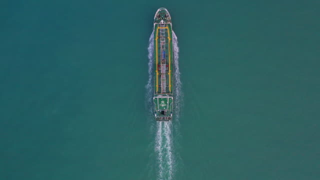 tanker ship aerial view, oil tanker and gas tanker sailing in open ocean. - nave cisterna video stock e b–roll