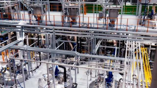 tanks and pipeline system at fertilizer production plant - fertilizzante video stock e b–roll