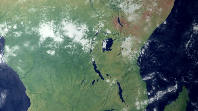 Tanzania pops up after earth zoom  (with alpha matte) View on the globe. Zooming in on the United Republic of Tanzania.  tanzania stock videos & royalty-free footage