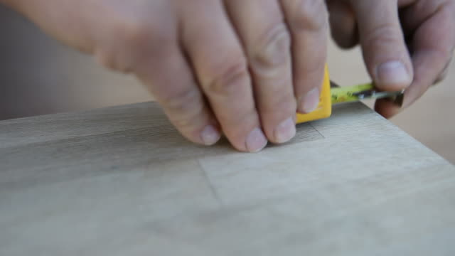 Tape measure tracking shot of a tape measure being used measuring stock videos & royalty-free footage