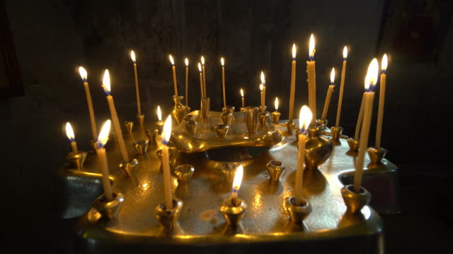 Taper Candles Burning in Church video