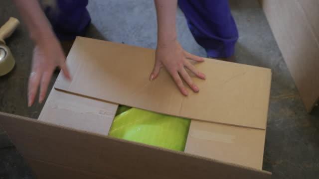 Taping the box Shut