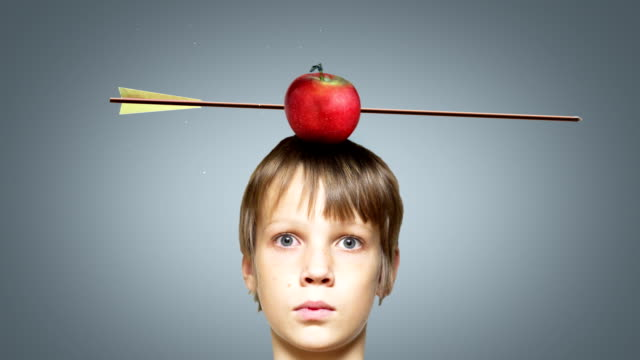 Target apple on boy's head - a master shot. video