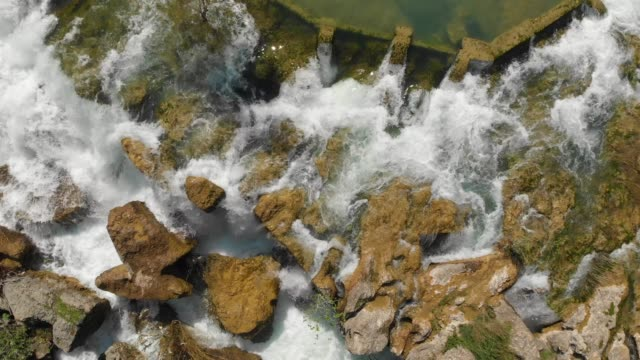 Tarsus Waterfall Directly above view of flowing water and waterfall in Tarsus, Turkey rapids river stock videos & royalty-free footage