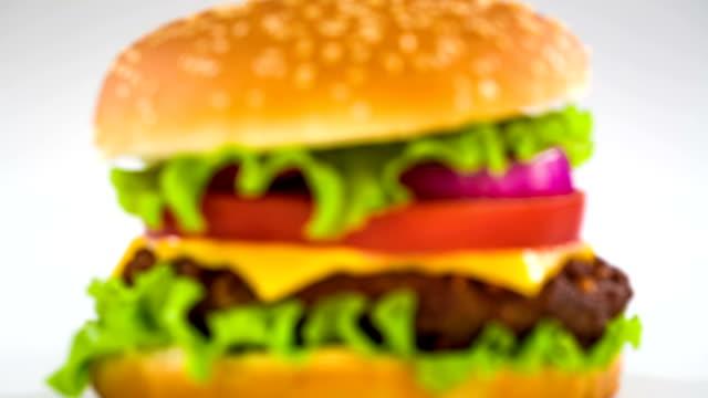 tasty and appetizing hamburger cheeseburger - sesamo video stock e b–roll
