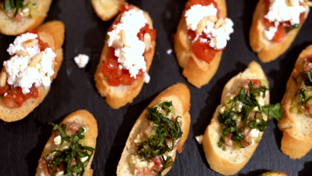 Tasty canapes SLOW MOTION: Close-up of colorful tasty canapes pine nut stock videos & royalty-free footage