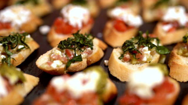 Tasty canapes Tasty fresh canapes served. pesto sauce stock videos & royalty-free footage