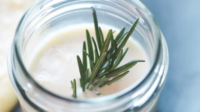 Tasty cream sauce with fresh rosemary in a small jar. Tasty cream sauce with fresh rosemary in a small jar. dipping sauce stock videos & royalty-free footage