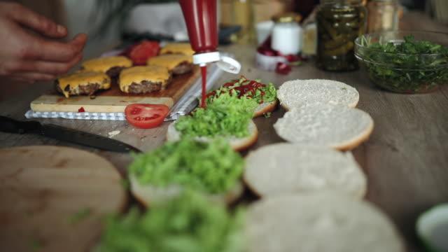 tasty homemade hamburgers - ketchup video stock e b–roll
