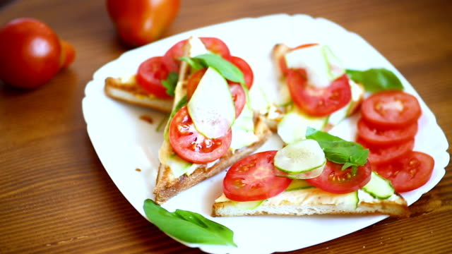tasty sandwich with curd paste, fresh cucumbers and tomatoes video