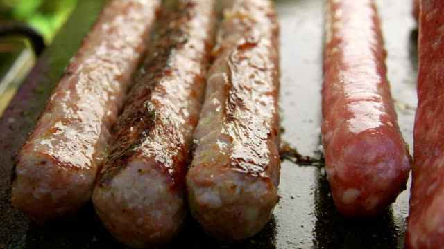 Tasty sausages on grill video