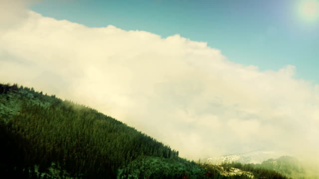 Tatra Mountains: Clouds over the tops with blue sky video